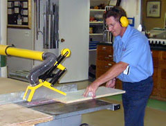 Worker using a table saw
